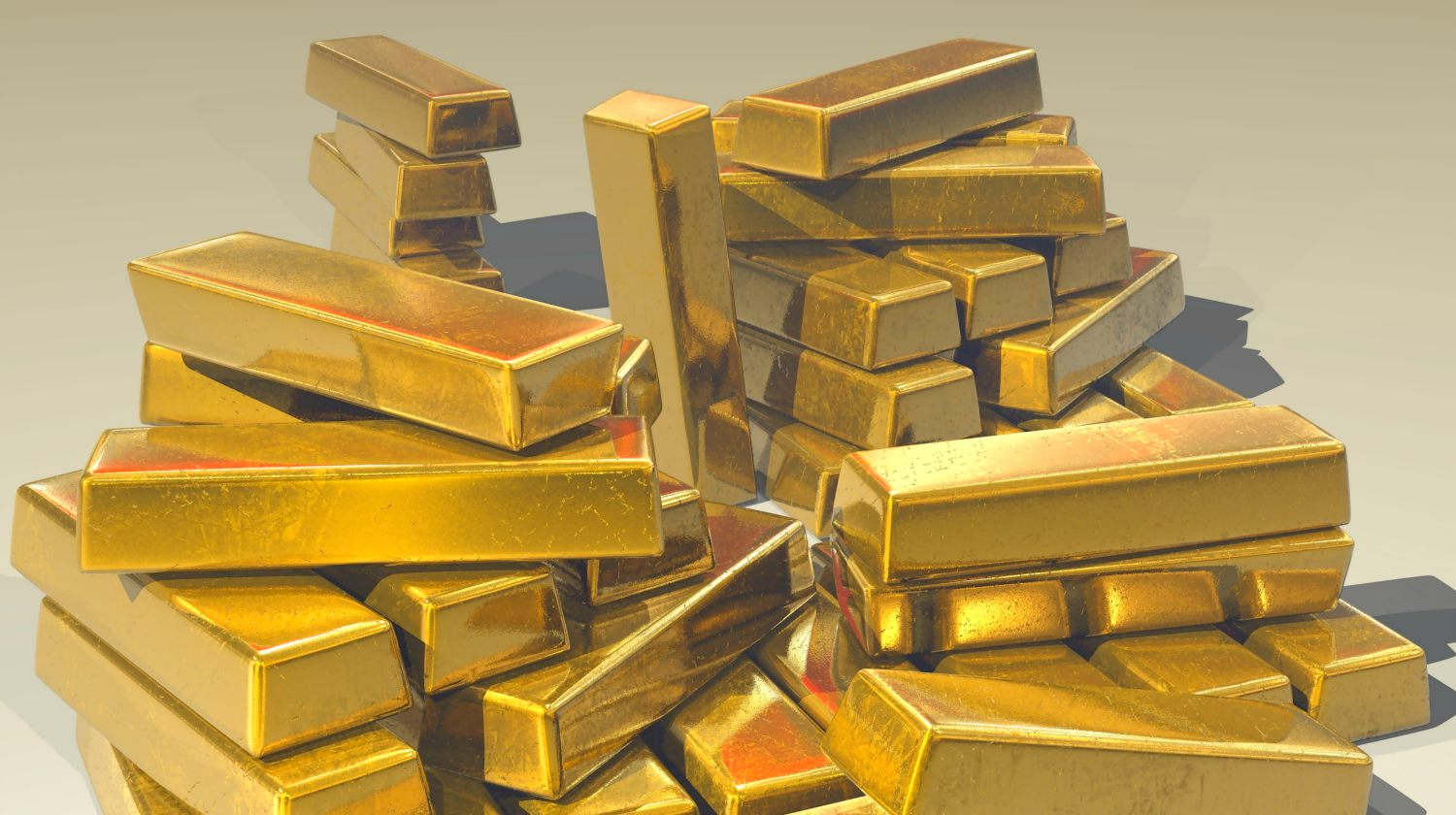pile of gold bars   Gold Price History   Everything You Need To Know   gold price history   gold market price   Featured