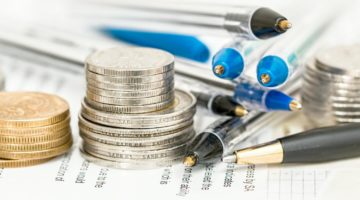 stack of coins and pens | The Best Retirement Calculators Recommended | Inside Your IRA | best retirement calculators | best retirement calculator for couples | Featured
