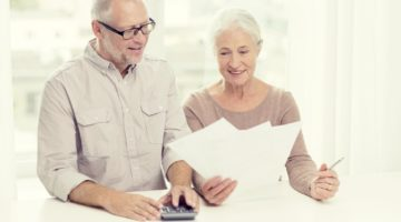 senior couple looking at documents | Tax Deferred Definition | What You Need To Know Inside Your IRA | tax deferred definition | tax exempt accounts | Featured