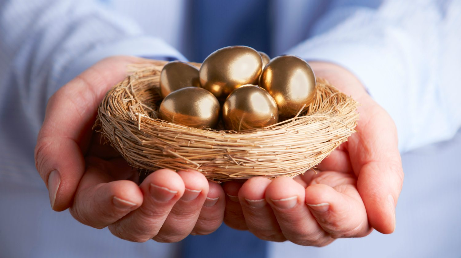 businessman holding nest full of golden eggs | What Is Gold IRA Rollover? | Inside Your IRA | gold IRA rollover | Precious metal | Featured
