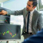 businessmen trading stocks online   How To Start Investing In Stocks: The Ultimate Guide   Inside IRA   investing in stocks   stock investments   Featured