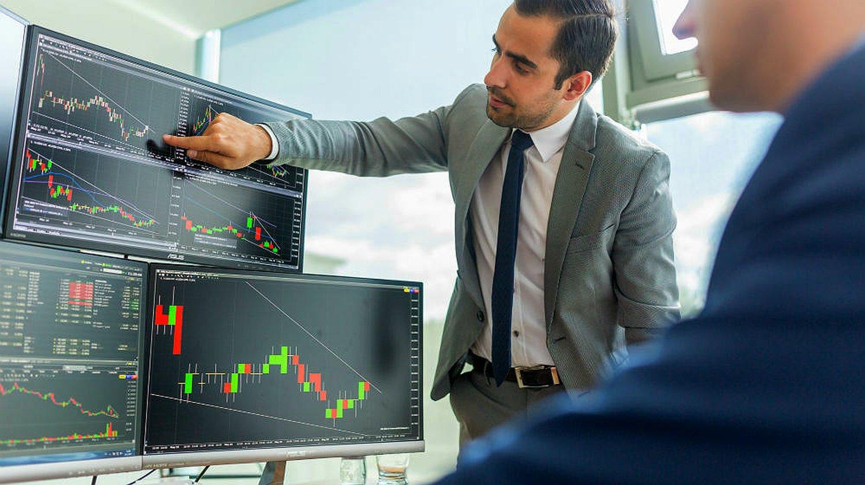 businessmen trading stocks online | How To Start Investing In Stocks: The Ultimate Guide | Inside IRA | investing in stocks | stock investments | Featured