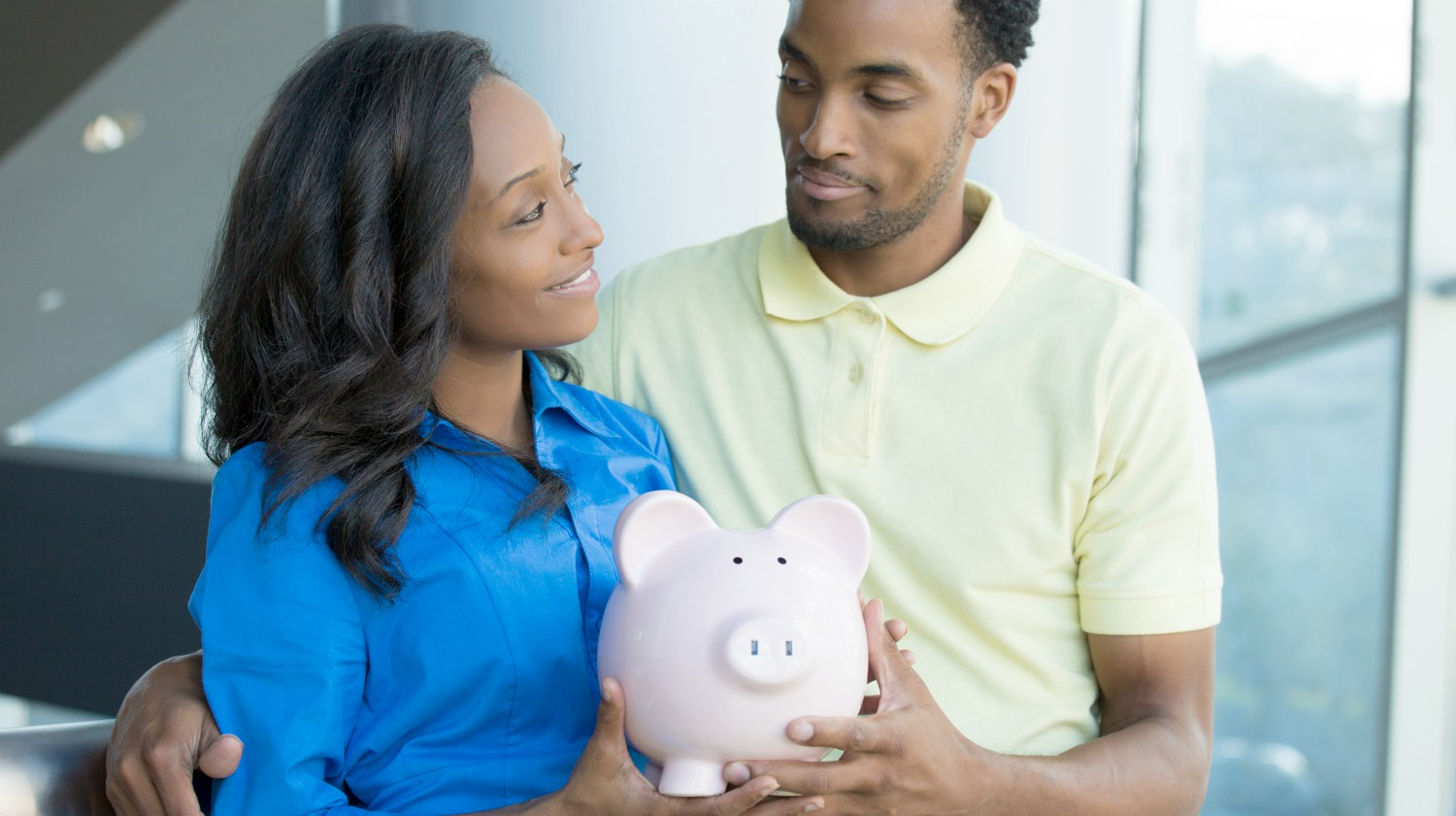 happy couple holding piggy bank | What Is A Roth IRA? What You Need To Know | Inside Your IRA | what is a Roth IRA | account | Featured