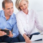 couple sitting on couch looking at the documents | What Is A Traditional IRA? | Inside Your IRA | what is a traditional IRA | traditional ira | Featured