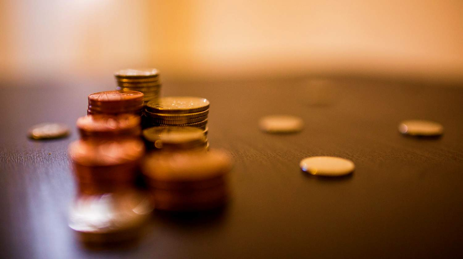 Featured | gold coins on table | Gold Prices and Chart [2018] | Inside Your IRA | Gold price