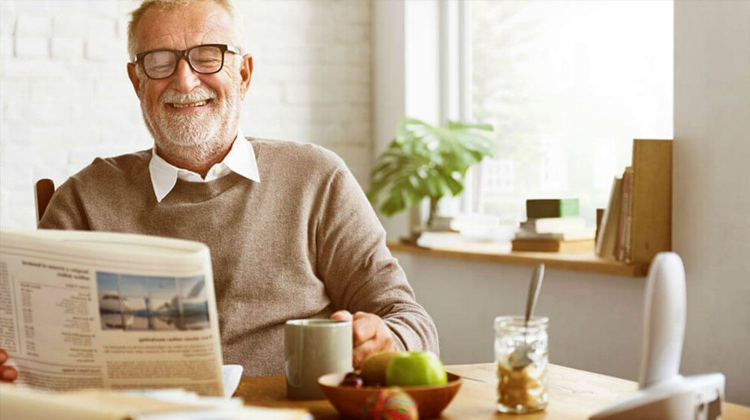 Featured | senior man happily drinking coffee while reading newspaper | How To Ace Your Retirement With These Tools | Inside Your IRA | retirement planning