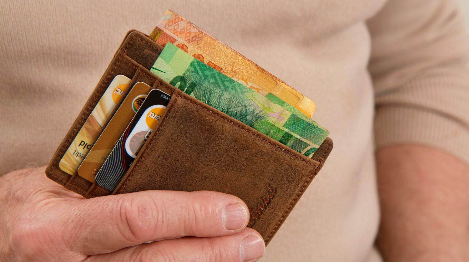 Featured   man holding wallet full of credit cards   What Is Investment Banking? And Other Investment Terms, Defined   Inside Your IRA   investment banking