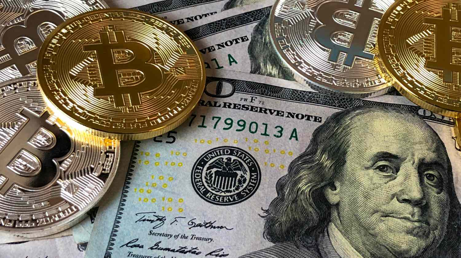 Feature   bitcoins and US dollars   Is Bitcoin A Good Investment? Volatility Factors To Consider   Inside Your IRA   number of cryptocurrencies