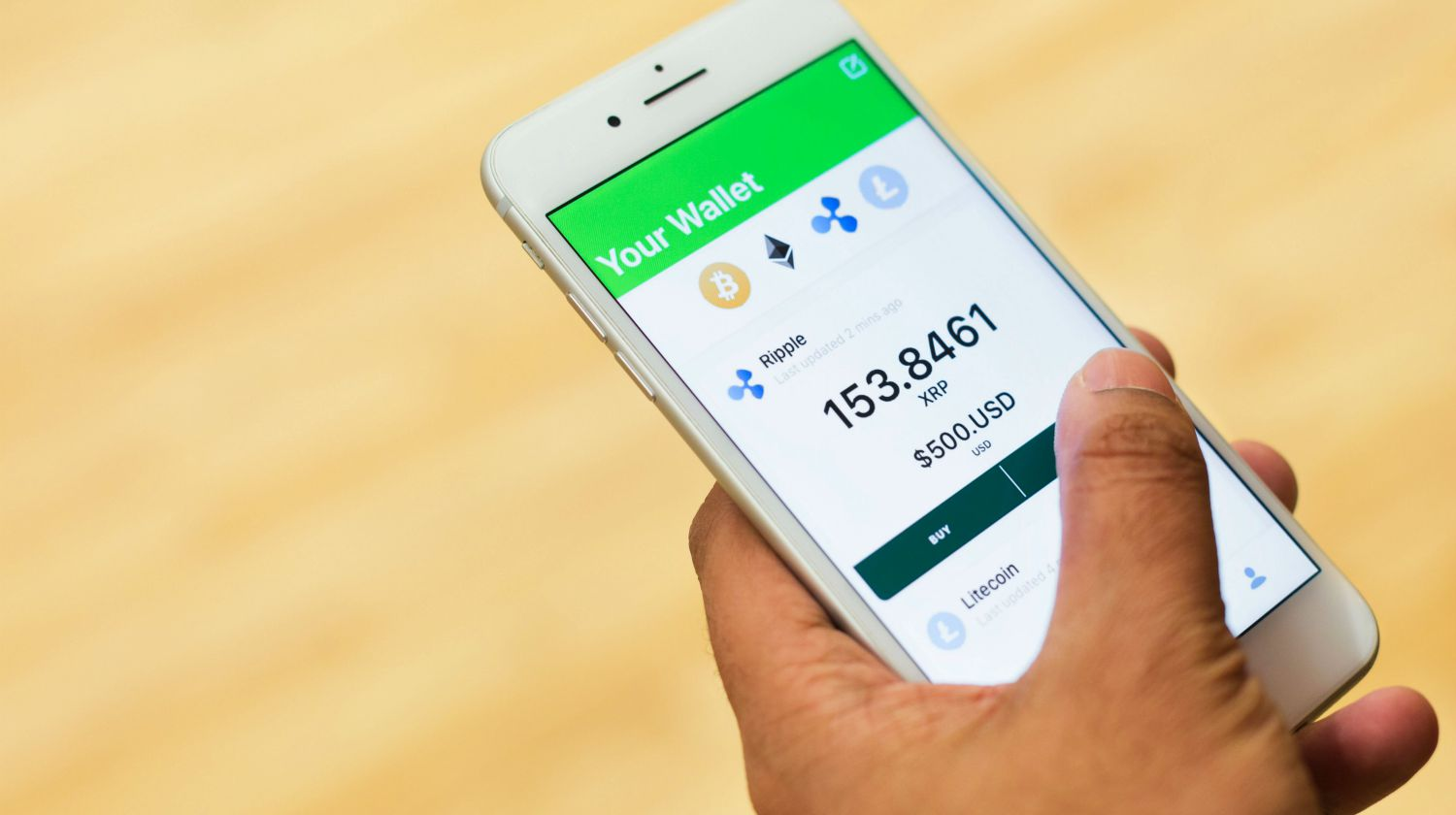Feature | person holding phone | Investment Apps For Seasoned Savers | Inside Your IRA