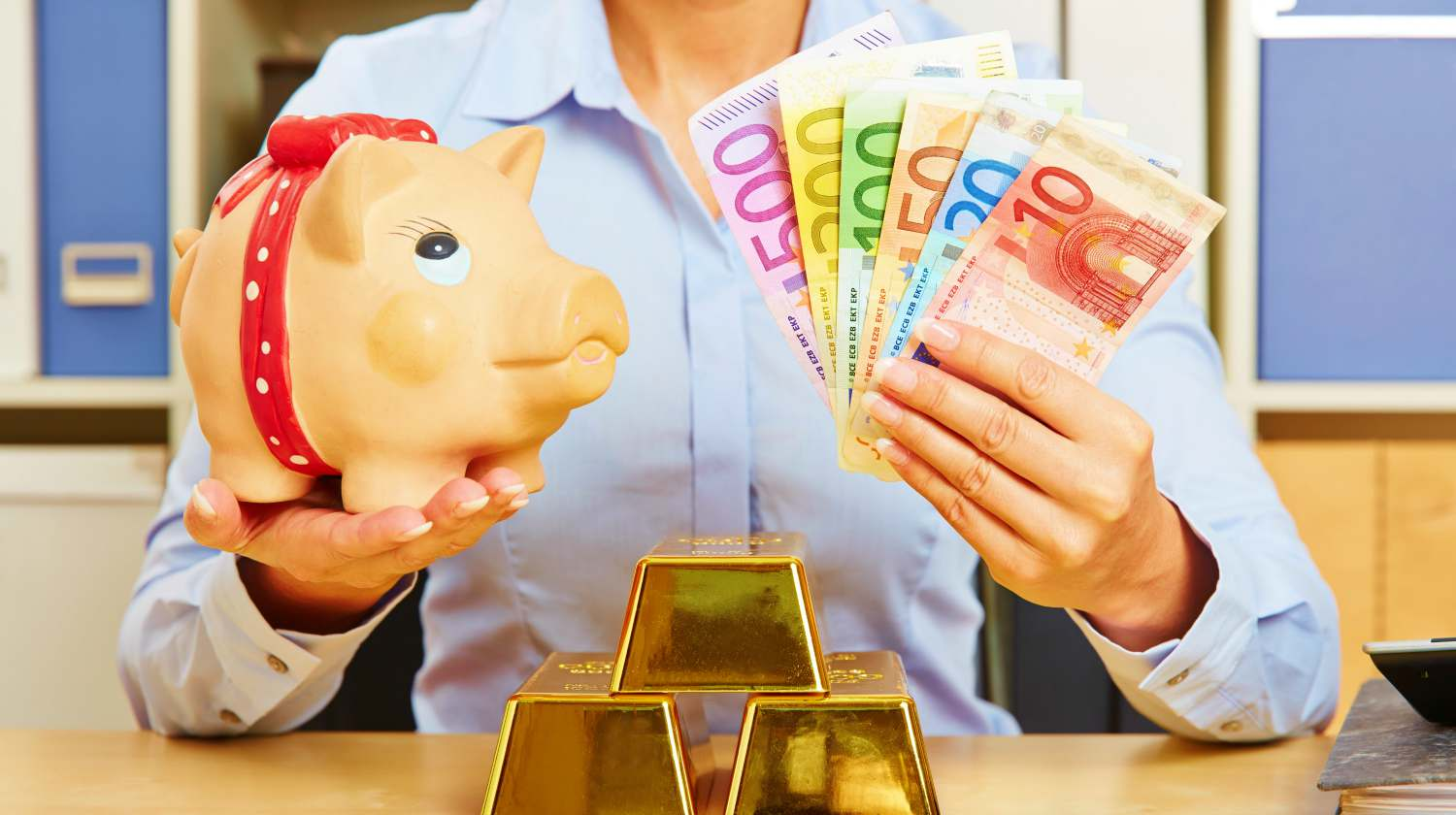 Feature | woman holding piggy bank and money | Best Long Term Investments For Securing Your Future | Inside Your IRA | long term investment ideas