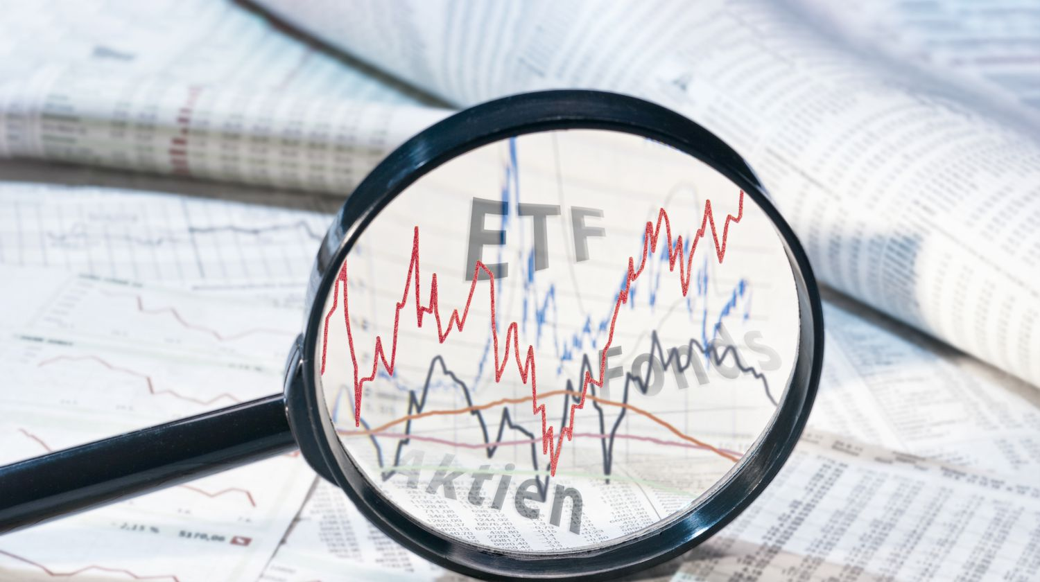 Featured | magnifying glass showing etf | What Are ETFs? Exchange Trade Fund Quick Start Guide | Inside Your IRA | funds