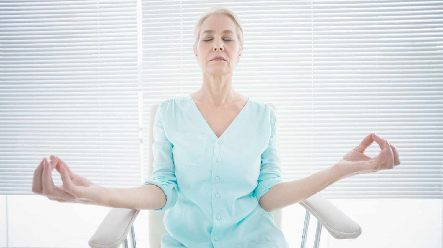 Featured   woman doing yoga   Chair Yoga For Seniors   Stay Fit And Flexible Through Retirement   Inside Your IRA