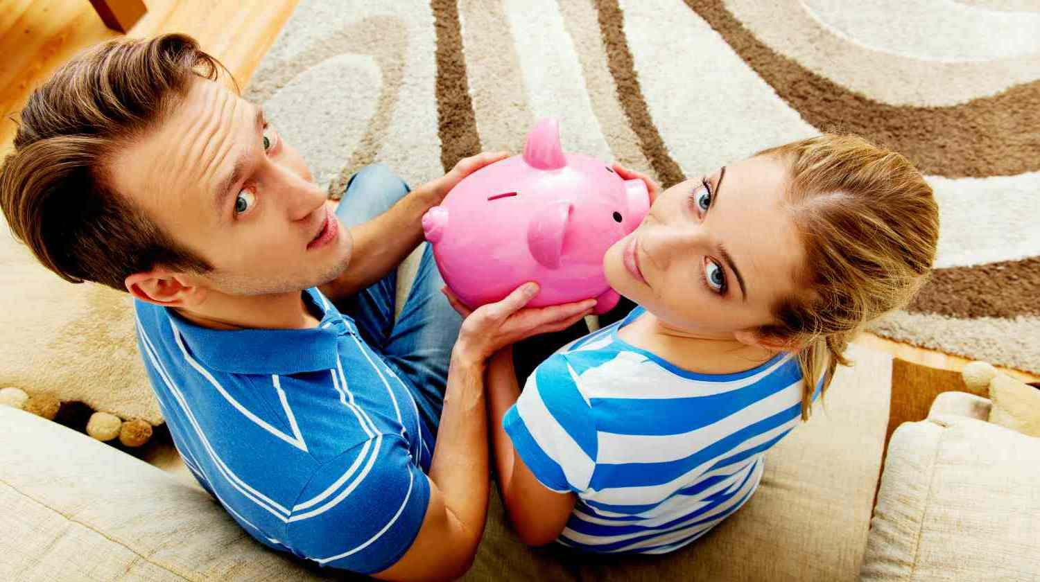 Feature | back view couple sitting on sofa | Roth IRA Rules You Most Likely Didn't Know Inside Your IRA | roth ira
