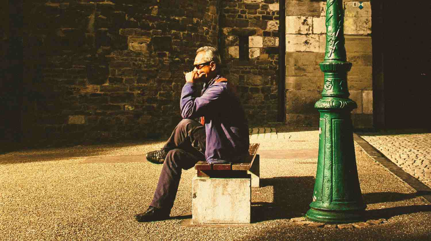Feature | senior man thinking on bench | When Can I Retire? | Questions To Ask Yourself Before Retiring