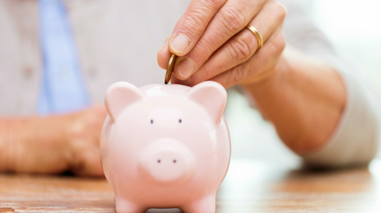 Featured | senior woman inserting coin in piggy bank | Senior Citizens Center | How To Save NOW For A Luxurious Retirement | Inside Your IRA | free stuff for seniors 55 and over