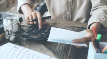 asian man working using calculator | Understanding Your 401(k) Statement | Inside Your IRA | 401k statement | understanding your 401(k) | Featured