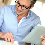 Feature   businessman working at home   Can You Buy Tax Liens and Deeds With Your IRA?   Inside Your IRA   what is a tax lien