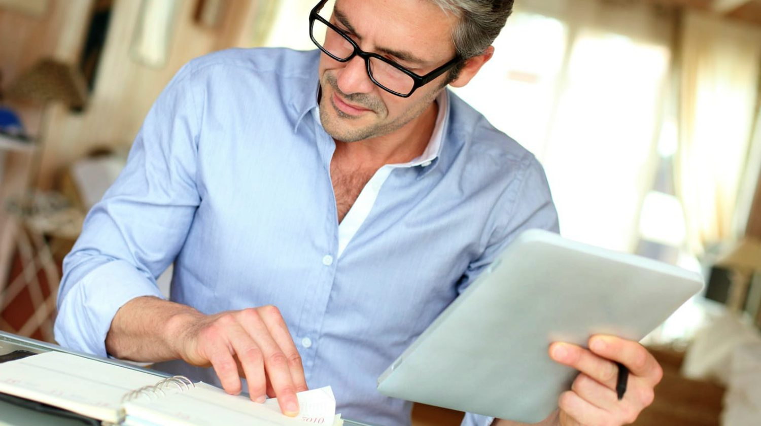 Feature | businessman working at home | Can You Buy Tax Liens and Deeds With Your IRA? | Inside Your IRA | what is a tax lien