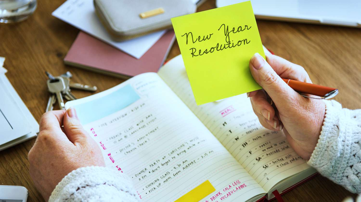Feature | new year resolution written on notepad | Financial Resolutions You Can Make For The New Year | Resolution