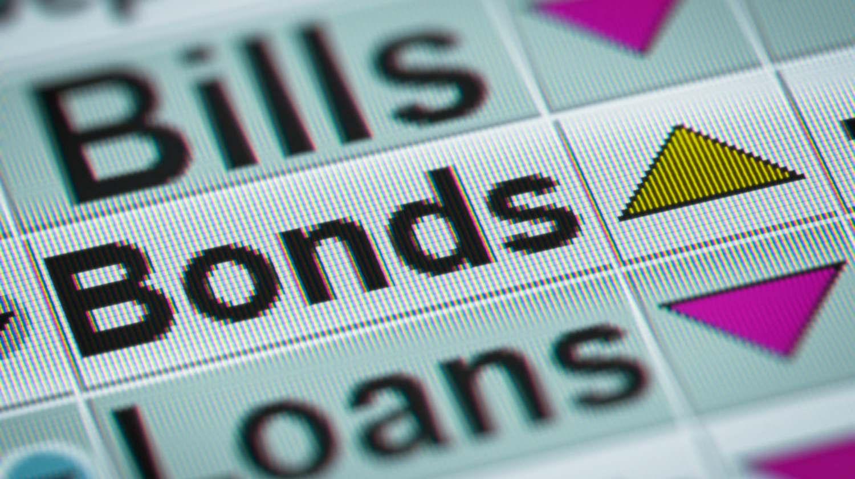 Featured | closeup shot of bills bonds loans | Bond Investment Strategies To Follow | Inside Your IRA | bond