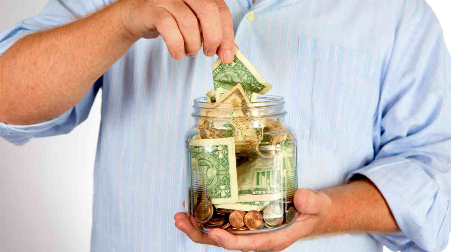 Feature | man withdrawing money | Top Retirement Investments | Inside Your IRA | inside your ira