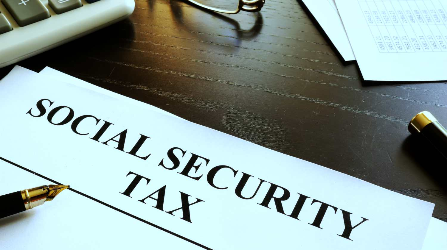 Feature | Social Security Tax written on paper | Social Security Tax: What Is It for and How Much Do I Pay for It | social security tax limit