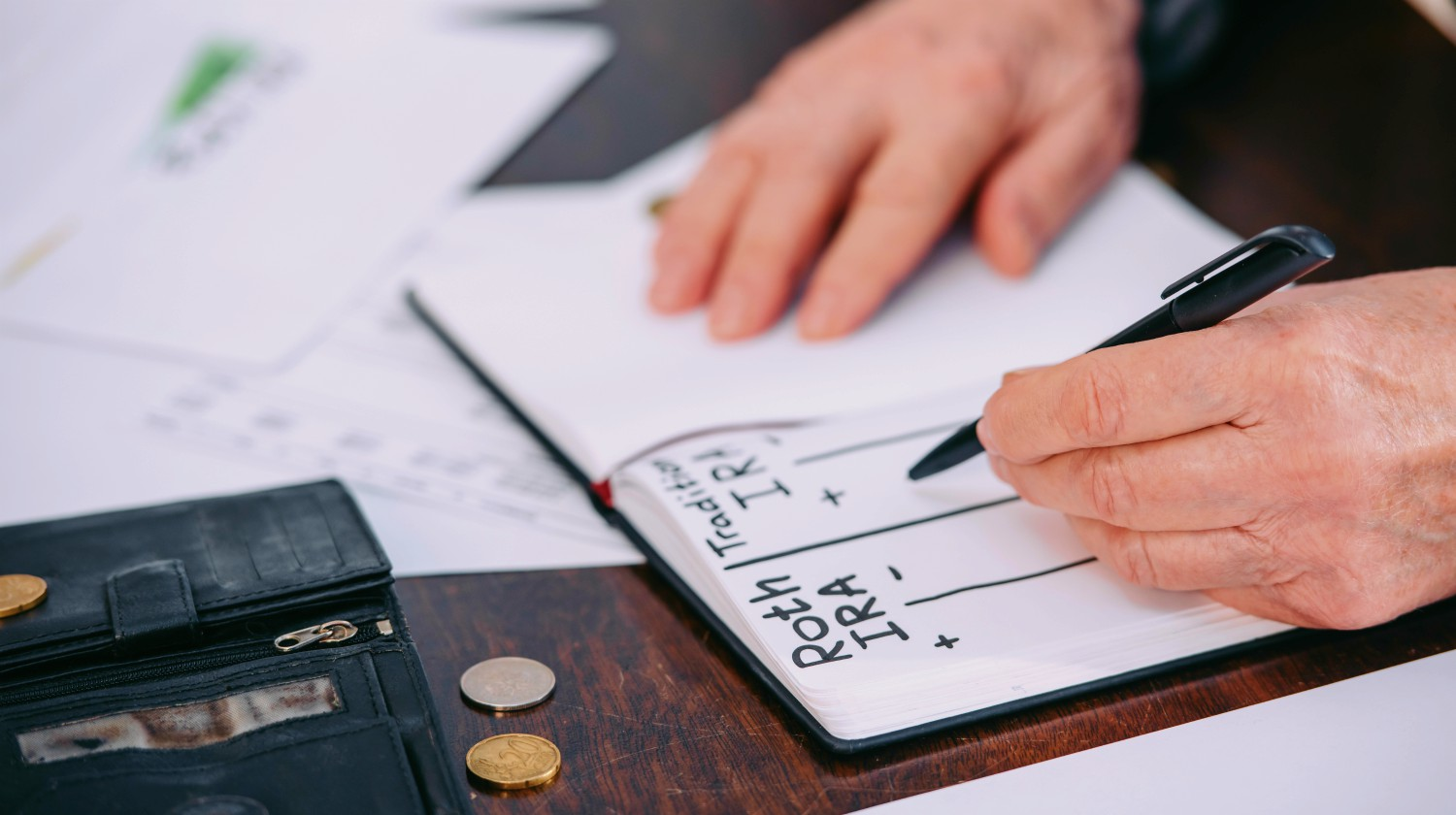 Feature | senior woman writing on notebook | Can You Have Multiple IRAs? | Inside Your IRA | multiple iras