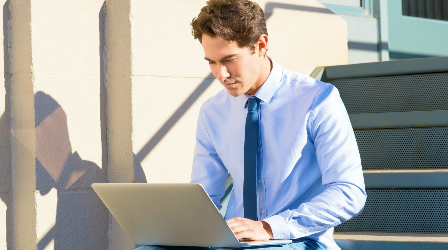 Feature | businessman using his laptop | What Is a Brokerage Account And Why Do I Need To Open One? | Inside Your IRA | what is a brokerage account