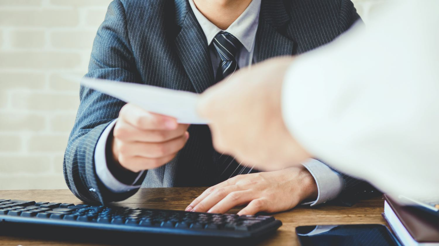 Featured   businessman passing document   What To Do When Your Employer Stopped Matching Your 401K   Inside Your IRA   401k employer match calculator
