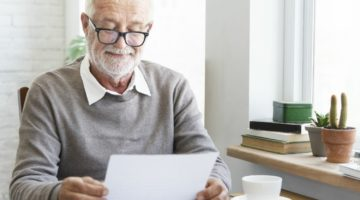Feature | senior reading document | How To Avoid Taxes On RMD (Required Minimum Distributions) | Inside Your IRA | required minimum distributions