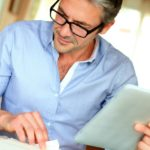 Featured | businessman working at home | When To Choose IRA Trust Over IRA LLC | Inside Your IRA | trust as beneficiary of ira