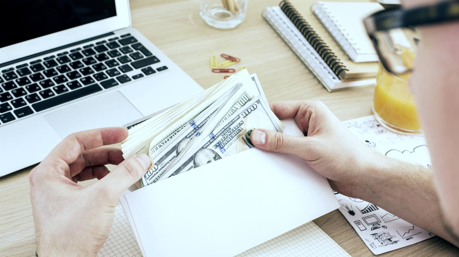 Featured | man counting money from an envelope | self directed ira fees | What Are Self Directed IRA Fees? Checklist Template