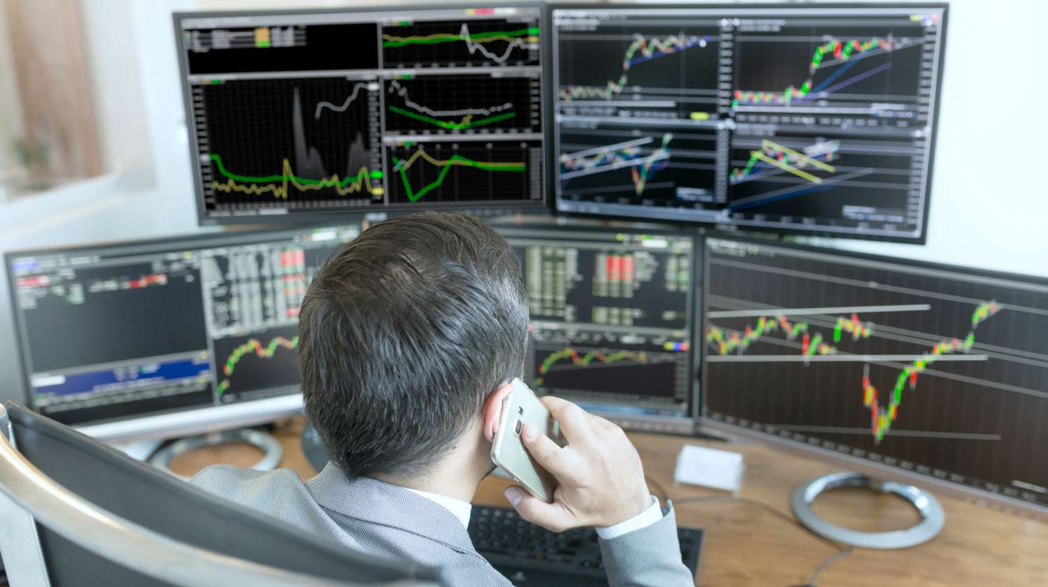 Featured | stock broker watching over trading updates | fintech stock