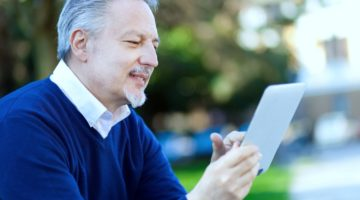 Featured | senior man using tablet | Checkbook IRA: What Is Checkbook Control? | Inside Your IRA | self directed ira checkbook